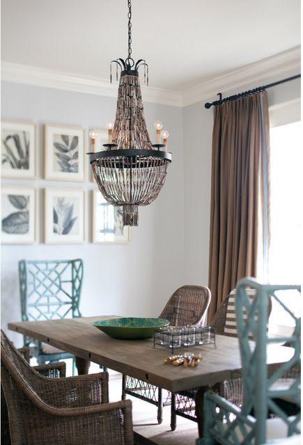 Blue is warmed up with wood tones here- in the curtains, table, and chandelier.