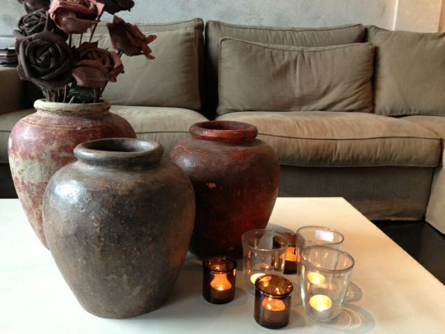 Textural contrast on a table top. Add candles and shiny glass to terracotta pots.  Via Molitli Interiers.
